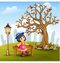 little girl sitting on city vector image