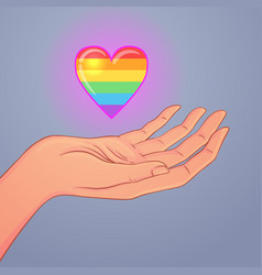 two open hands raised up holding rainbow heart vector image