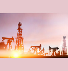 darck silhouette oil rig and pumps during sunset vector image