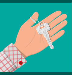 hand with metal key vector image