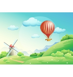 summer fields with a mill and a balloon in s vector image