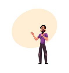Young latin man singing karaoke holding vector