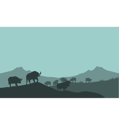 Bison silhouette in hills scenery vector