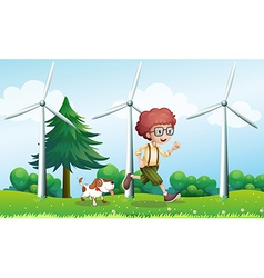 A boy running with a dog near the three windmills vector image vector image