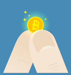 Fingers hold a small bitcoin vector