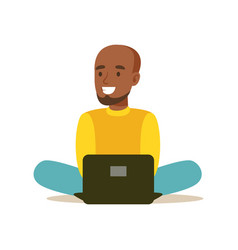 young man sitting on the floor and using laptop vector image