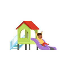 cute little boy playing on a slide kid having fun vector image