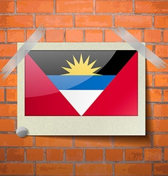Flags of Antigua and Barbuda scotch taped to a red vector image