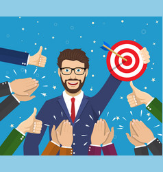 businessman holding up a winning target vector image
