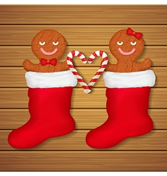 loving couple of gingerbread cookies in red socks vector image