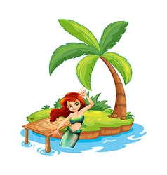 A young mermaid in the island vector image