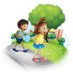 A girl and a boy walking along the street vector