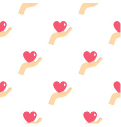 Hand holding a pink heart pattern seamless vector
