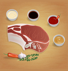 Raw organic pork chop with herbs and sauces on vector
