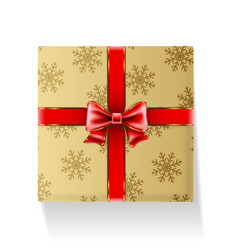Gift packaged in golden box with ribbon and bow vector