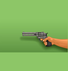 hand holding revolver on green vector image