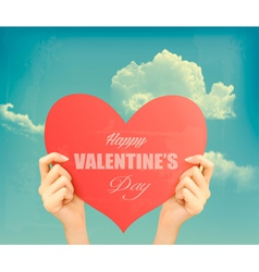 Two hands holding red heart valentines day retro vector