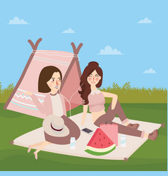 Teenagers sitting on the ground in front of tents vector