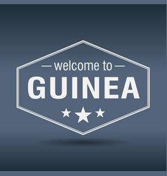 welcome to guinea hexagonal white vintage label vector image