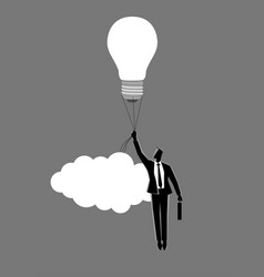businessman holding a floating light bulb vector image
