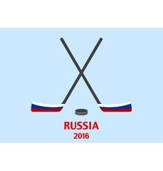 Hockey sticks and puck with the Russian flag vector image