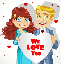 Man and woman holding banner heart We love you vector image