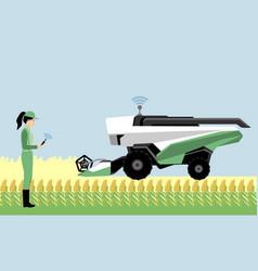 A woman farmer with autonomous combine harvester vector