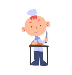 Boy chef cook cutting loaf bread with knife cute vector