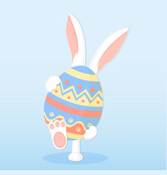 Easter bunny holding a big paschal egg vector