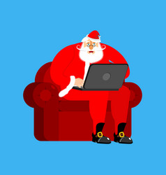 santa claus on chair working in laptop christmas vector image