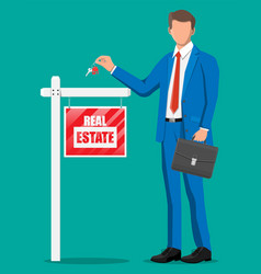businessman or realtor holding key vector image