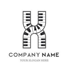 x letter logo design piano keyboard logo vector image