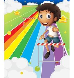 A little boy near the stripe hurdle vector