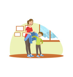 Mother helping her son to get dressed loving mom vector