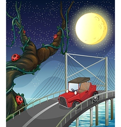 A vintage car passing across the bridge vector image vector image