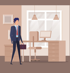 Businessman with suitcase and desk with computer vector
