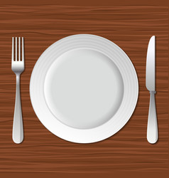 Blank Plate Fork and Knife on Old Wooden Table vector