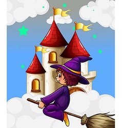 A witch riding in broom near the castle vector