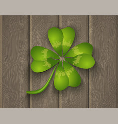 lucky clover on wooden background vector image