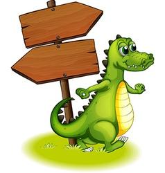 A crocodile beside the wooden empty arrowboard vector image