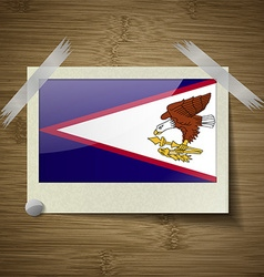 Flags american samoa at frame on wooden texture vector