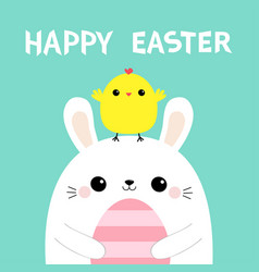 happy easter bunny holding striped painting egg vector image