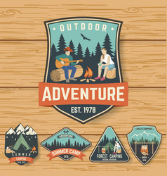Set of summer camp badges on the wood board vector