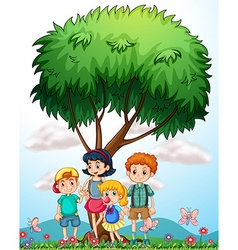 Children standing under the tree vector