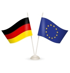 Table stand with flags of germany and us vector
