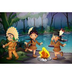 Three Indian kids inside the forest vector image