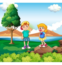 Two kids at the riverside vector image