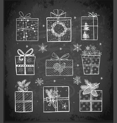 christmas gift boxes on blackboard background vector image vector image