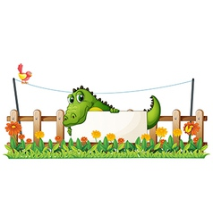 A crocodile in the fence vector