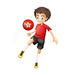 A soccer player using the ball with the flag of vector